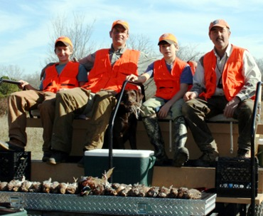 Father and sons after a good quail hunt